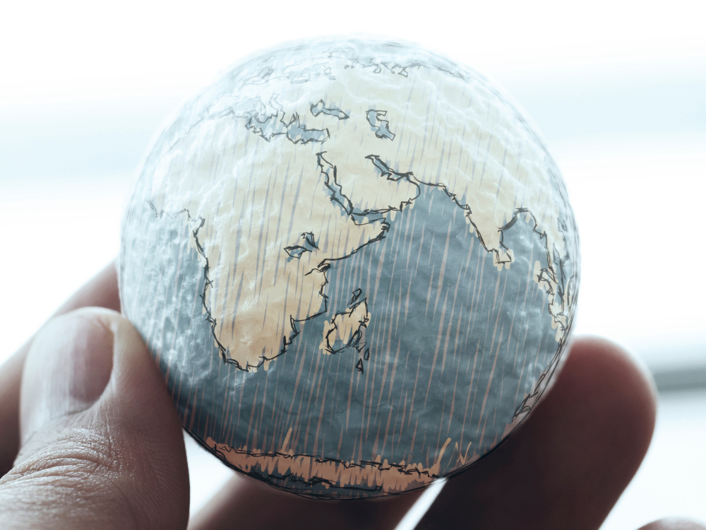 Person holding world in hand